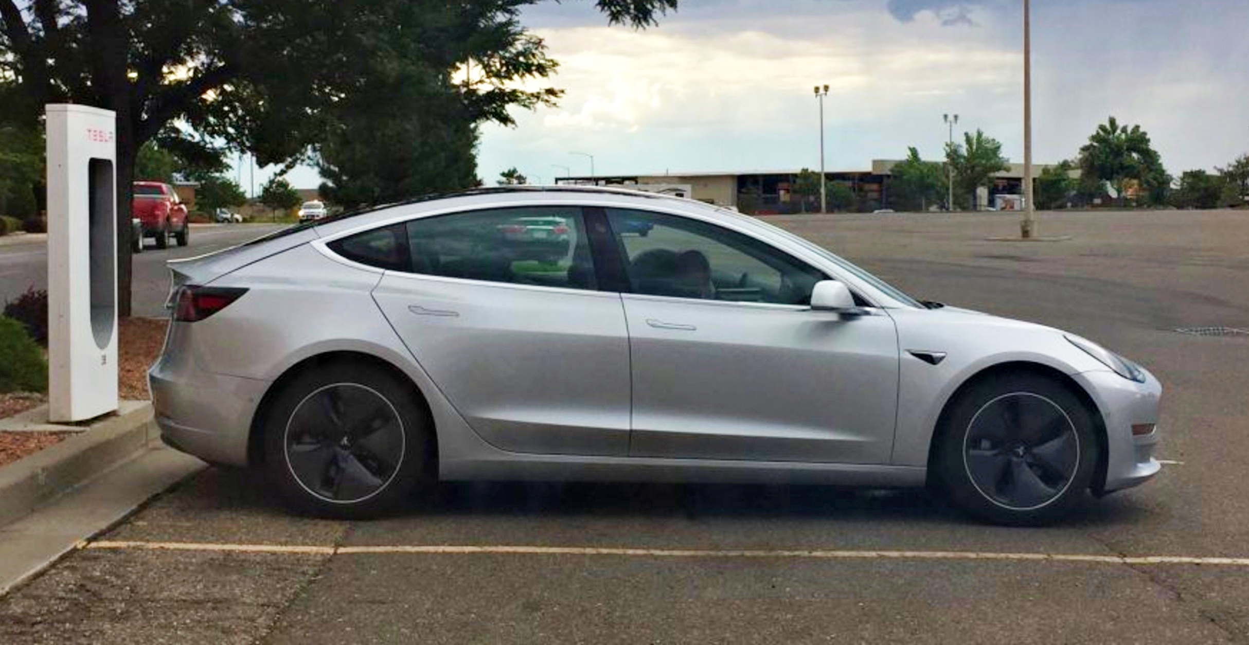 silver-tesla-model-3-side-supercharger