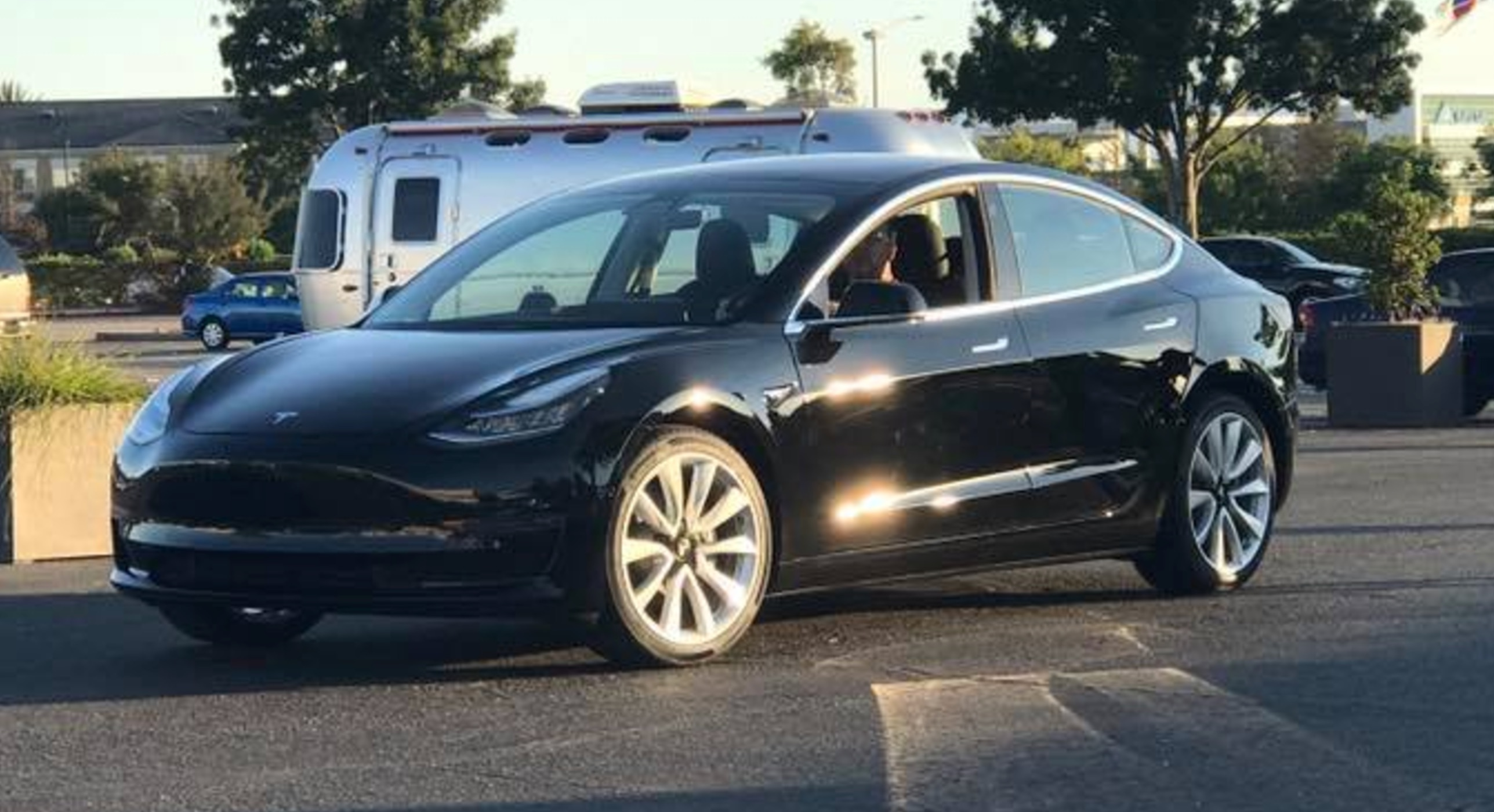 first photo of tesla model 3 production car musk  ted