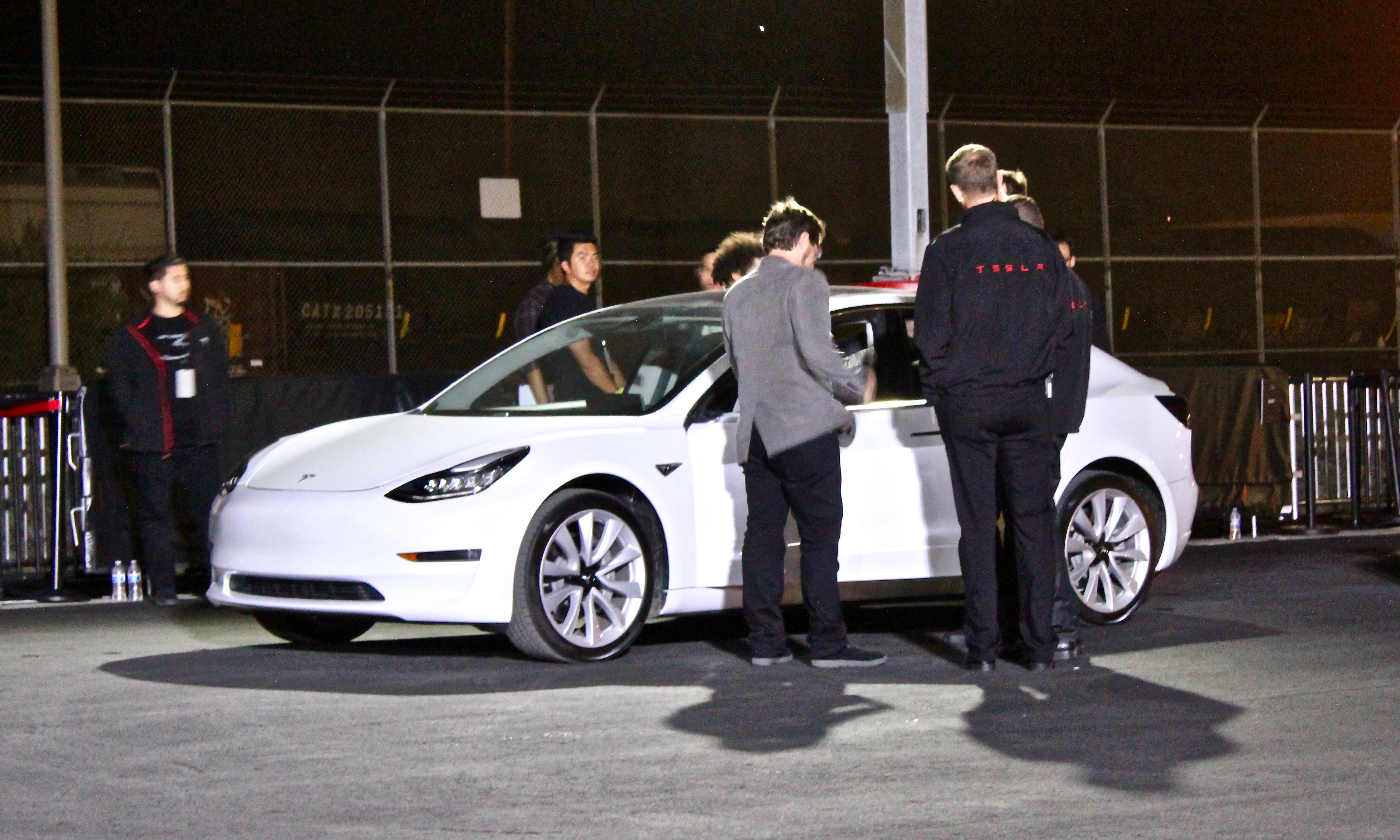 White production Model 3 giving test rides at Fremont factory Delivery Event on July 28, 2017 [Source: Teslarati]
