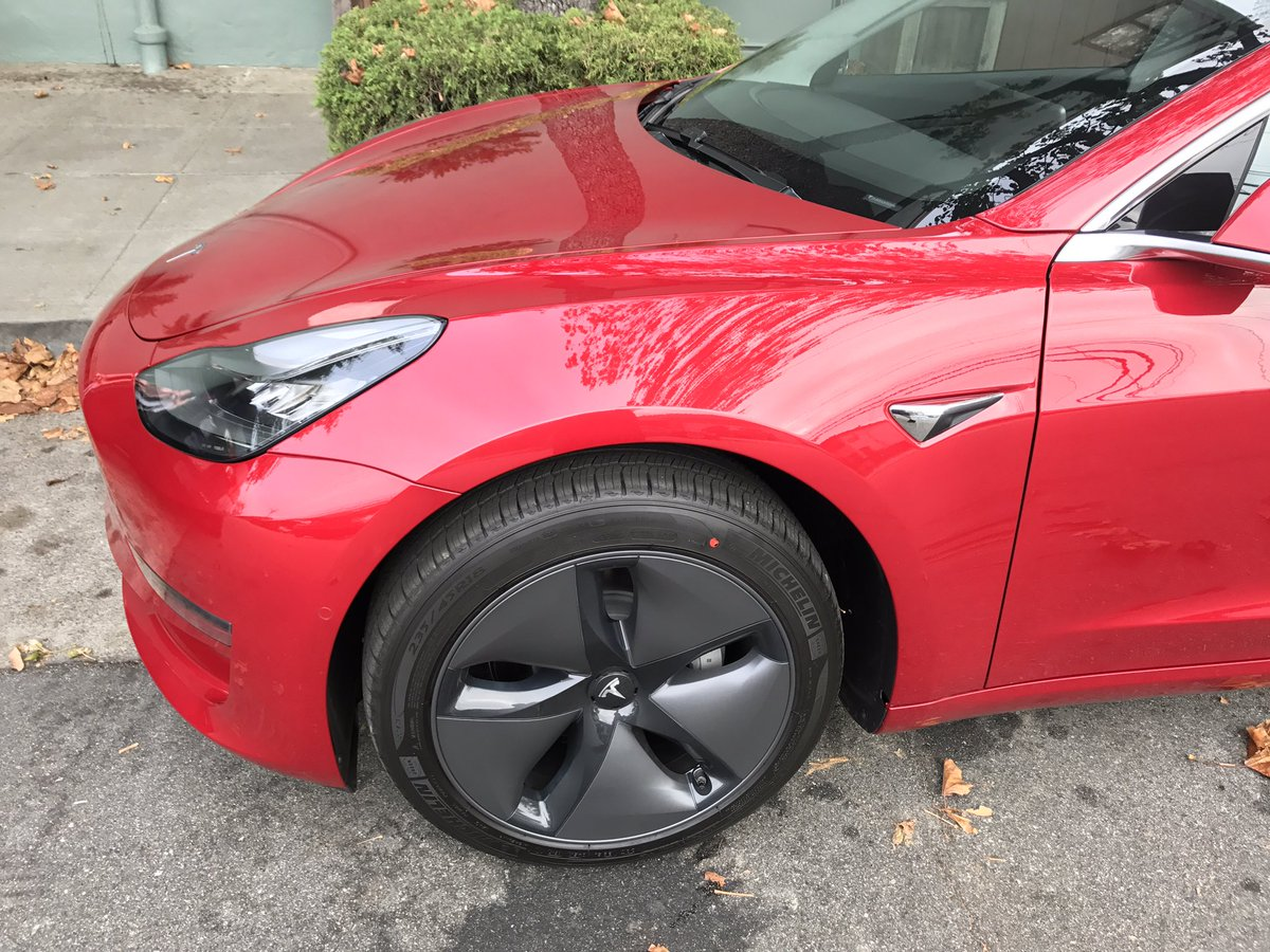Tesla Model 3 Red side
