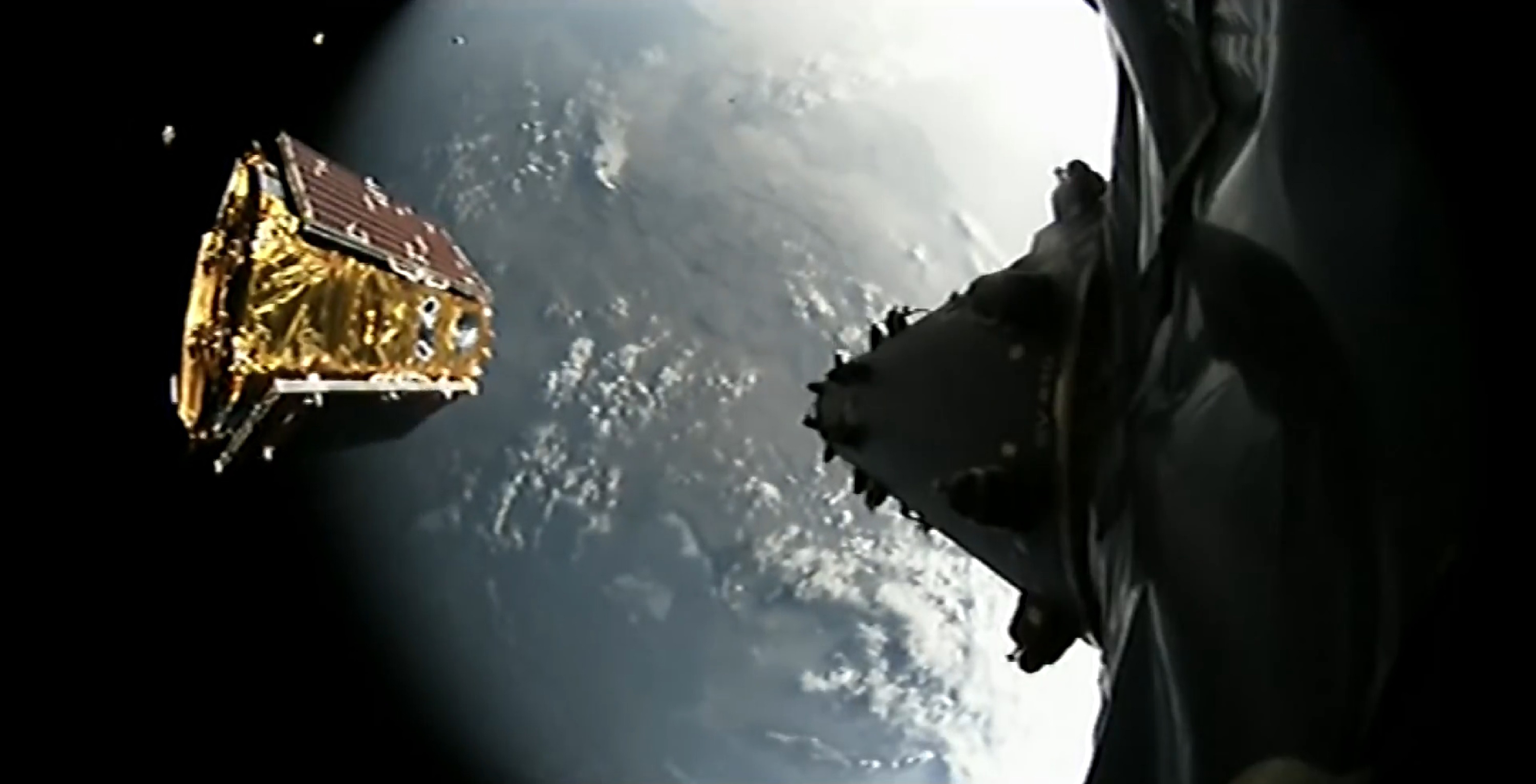 A truly picturesque live view of the Iridium NEXT Mission 3 satellite deployment. Four sats are visible in an arc on the left. Starlink will be denser and smaller, but will deploy similarly. (SpaceX)