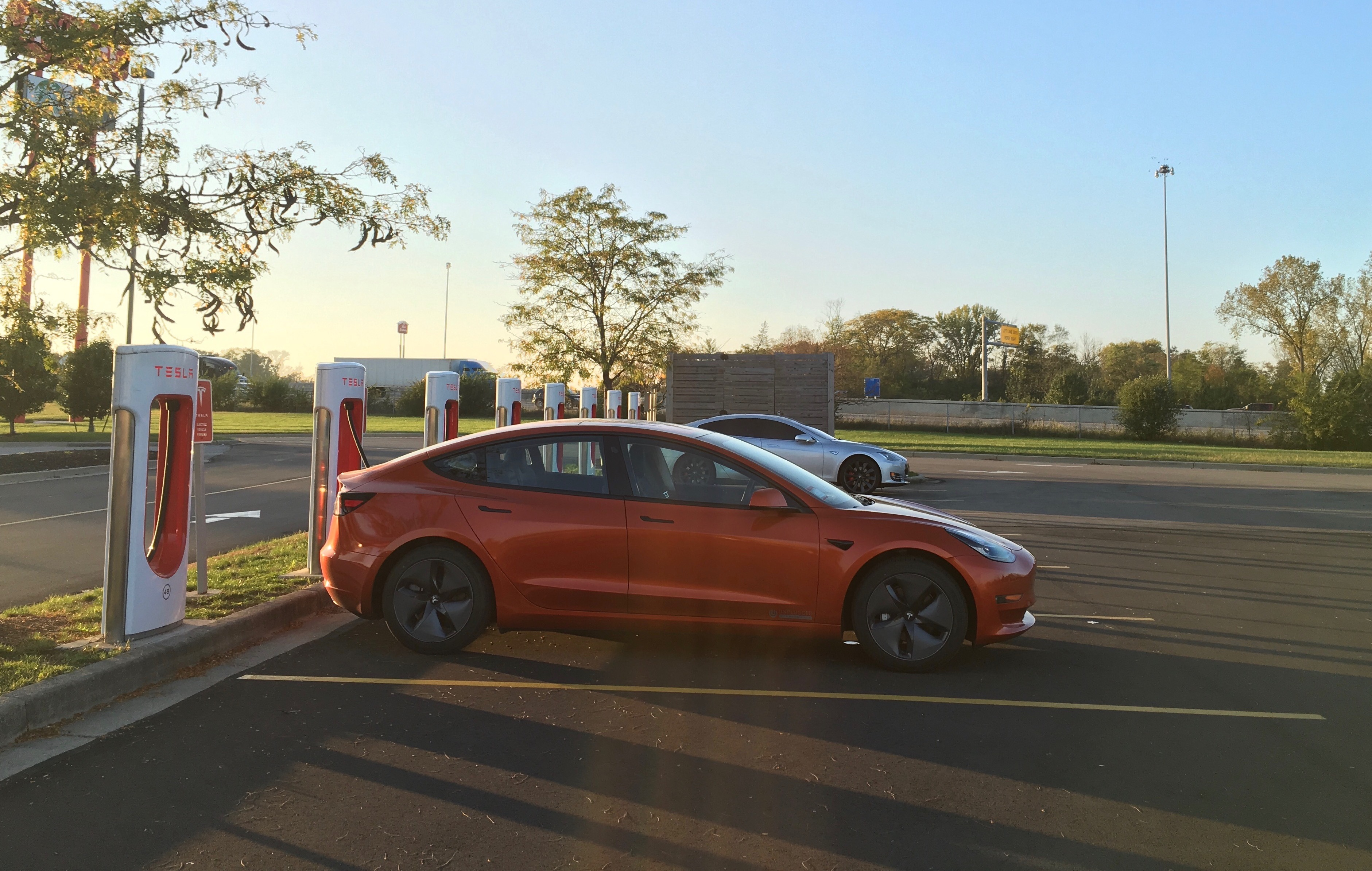 orange-tesla-model-3-supercharger