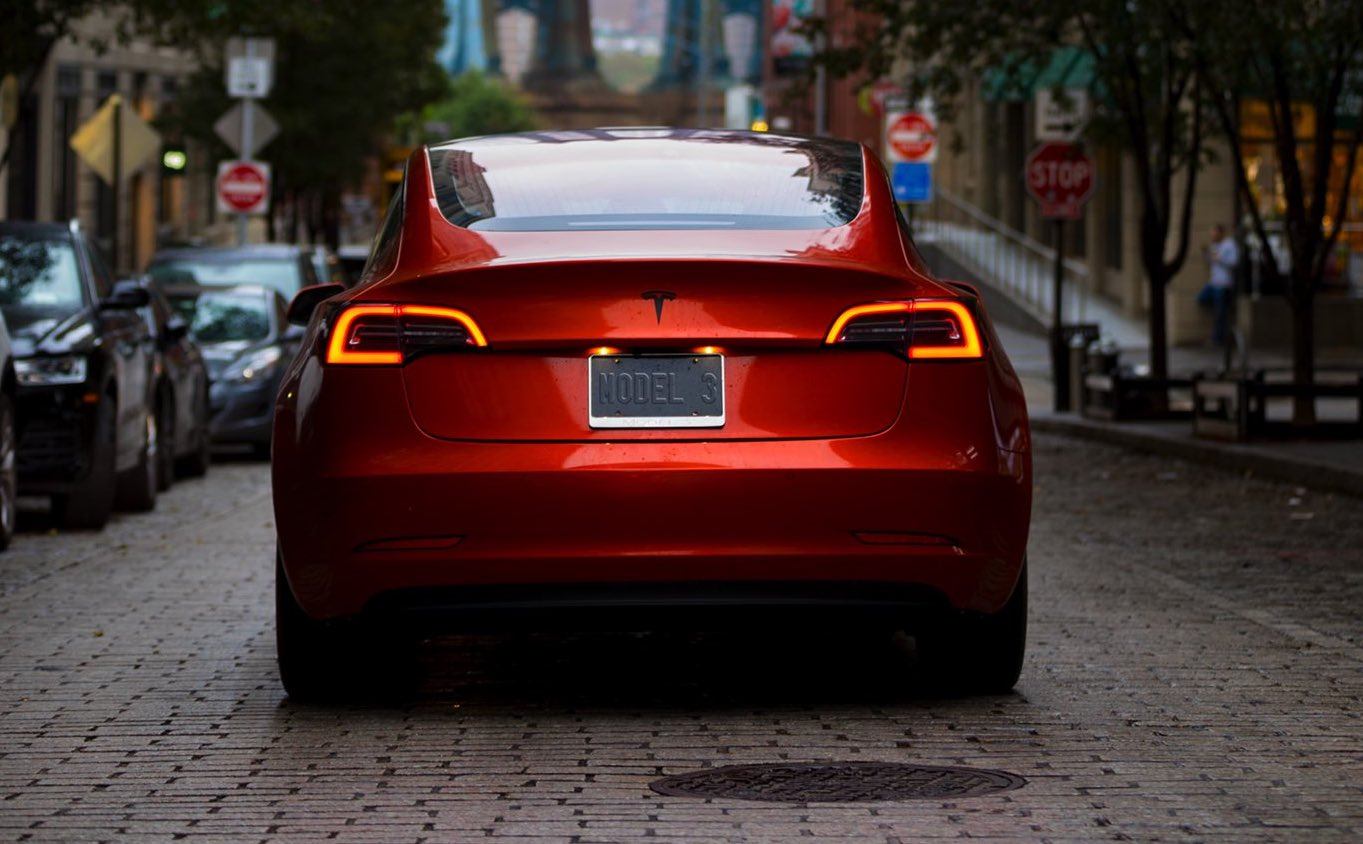 orange-wrap-tesla-model-3-nyc-rear