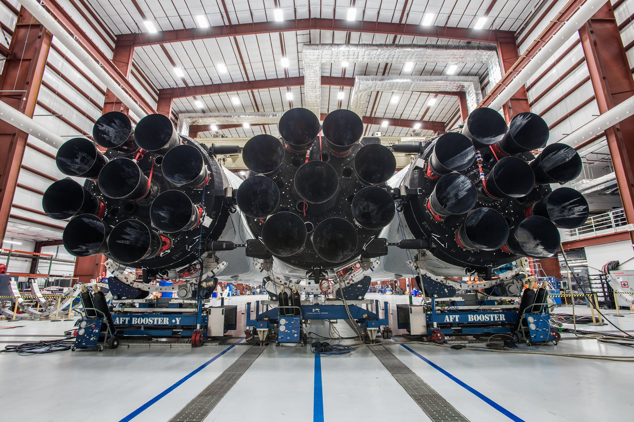 Falcon Heavy's 27 engines on display at 39A. The white material on the left and right engines are indicative of flight-proven boosters. (SpaceX)
