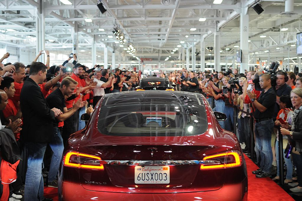 Tesla Model S workers [Credit: jurvetson/Flickr]
