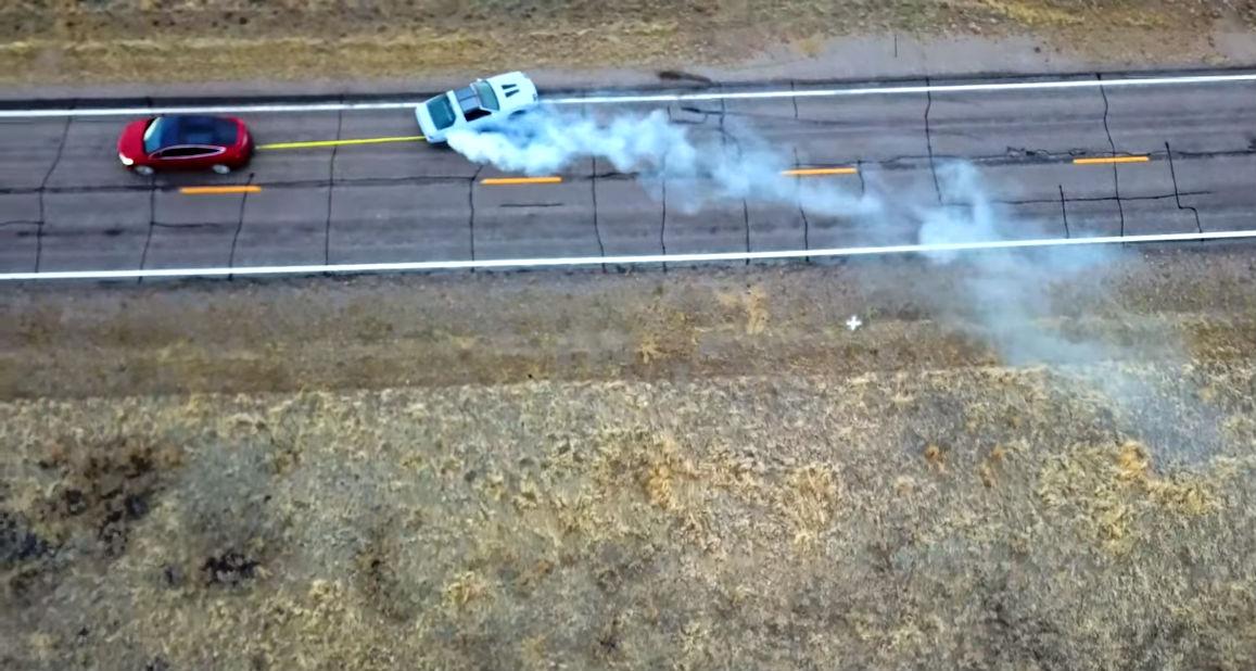 Tesla Model X Chevy Camaro tug-of-war [Credit: Tesla Trip/YouTube]