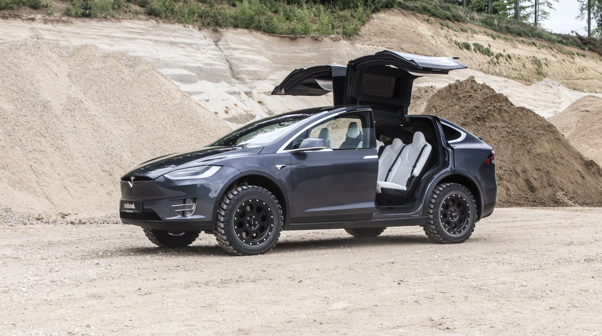 tesla model x looks like a beast with some off road treatment. Black Bedroom Furniture Sets. Home Design Ideas