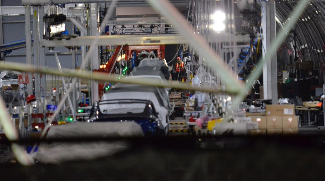 Tesla Solar Battery >> Spy shots inside Tesla's giant tent suggest assembly line buildout in progress