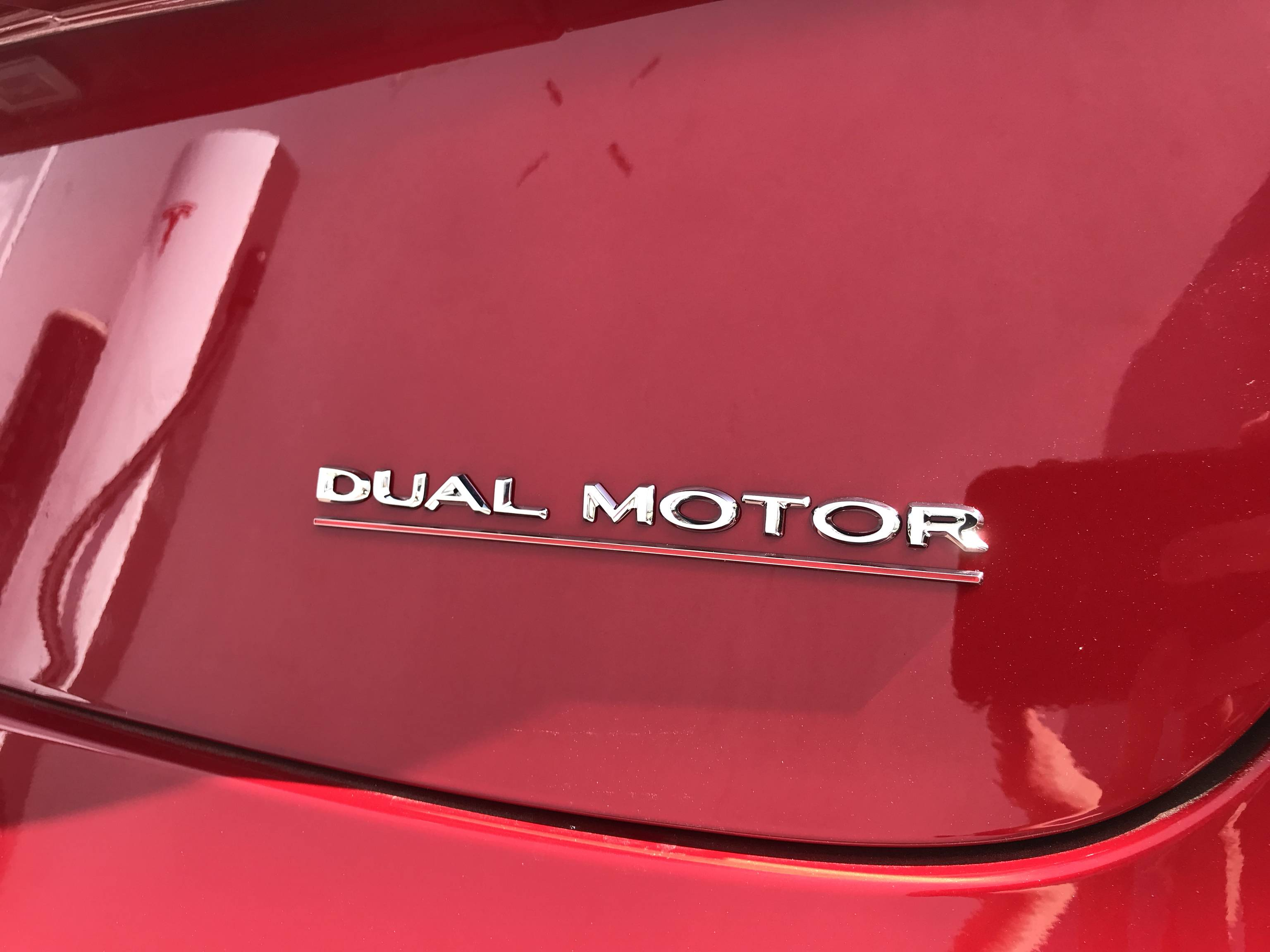 model-3-performance-spoiler-badge-2