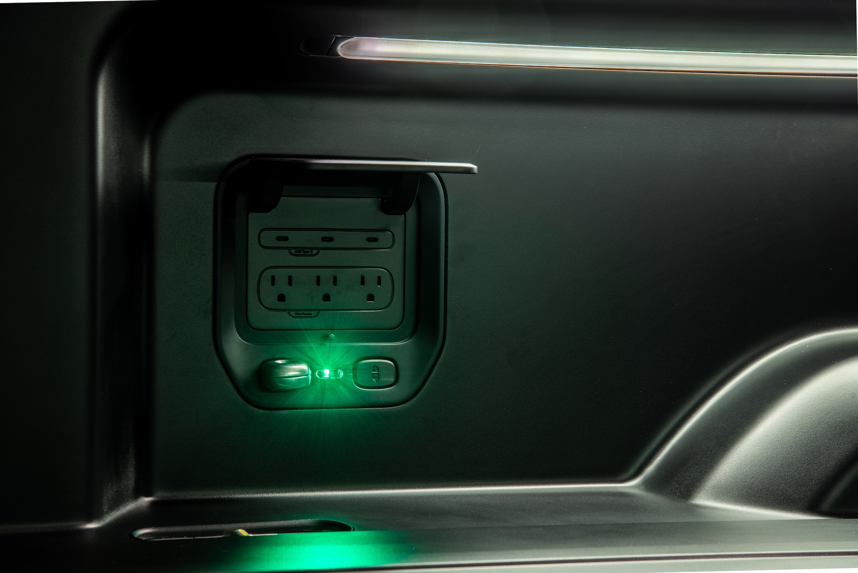 G. Rivian_R1T_Bed_Power_and_Gear_Guard