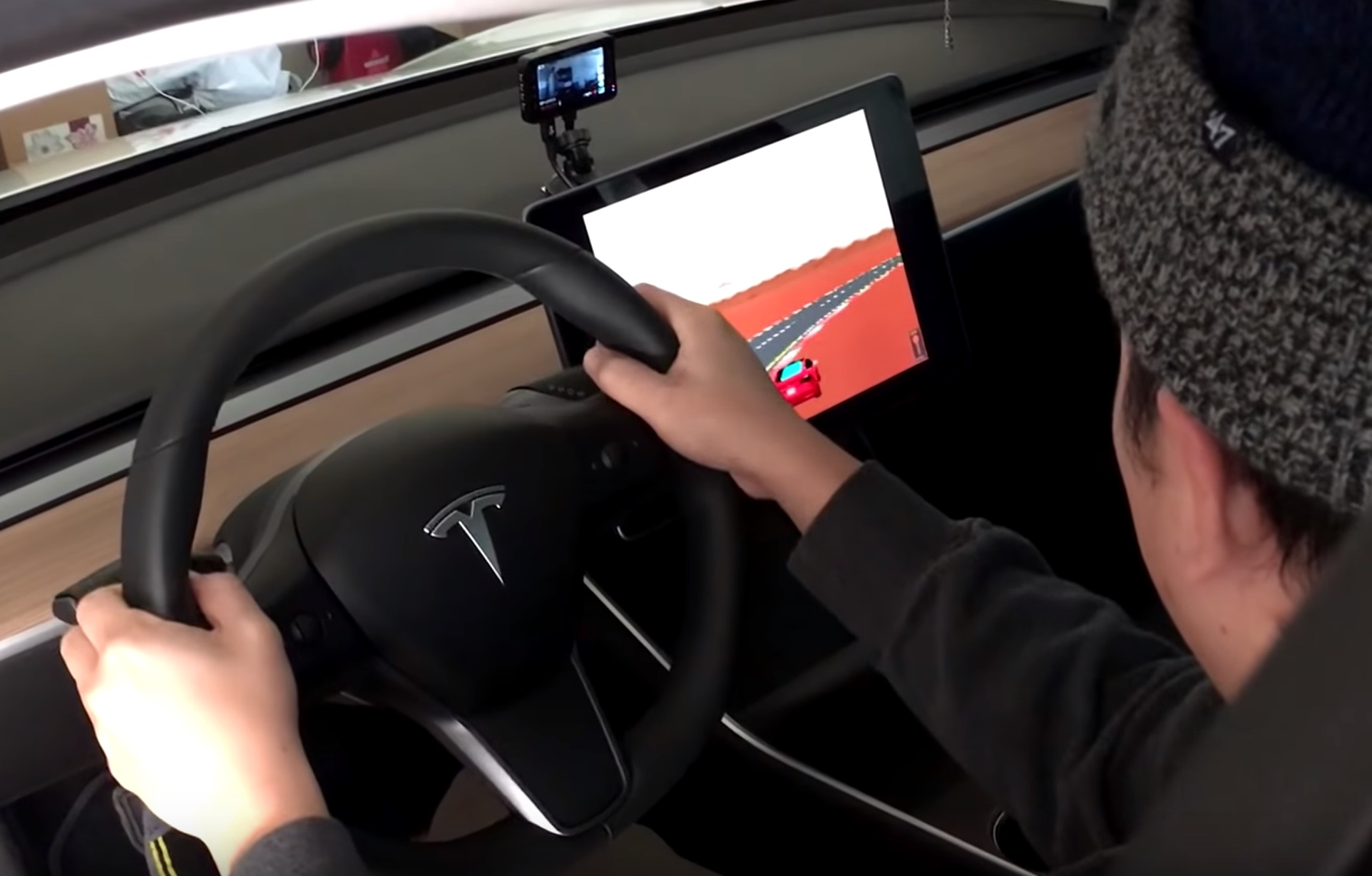 Tesla rolls out classic Pole Position game for in-car