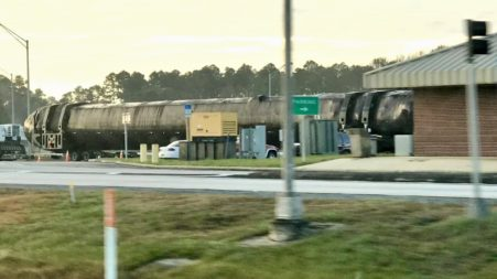 SpaceX Falcon 9 booster spied on highway as triple-satellite