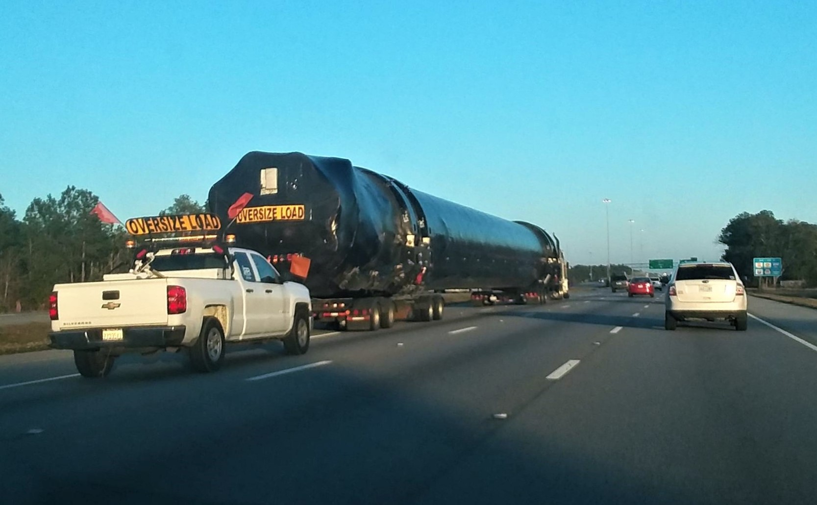 SpaceX Falcon 9 booster spied on highway as triple-satellite launch