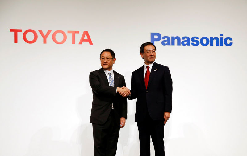 Toyota Motor Corp President Toyoda and Panasonic Corp President Tsuga attend a photo session after a joint news conference in Tokyo