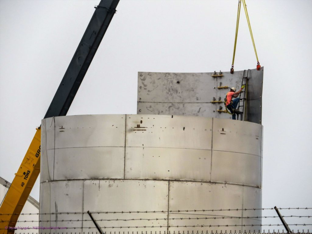 According to CEO Elon Musk, this large metal cylinder is indeed one of the barrel sections of the first orbital Starship prototype. Workers weld the sections together outside, in rain or shine. (NASASpaceflight - bocachicagal)
