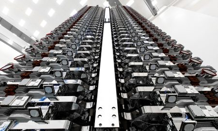 A stack of 60 Starlink v0.9 satellites are prepared for their orbital launch debut in May 2019. (SpaceX)