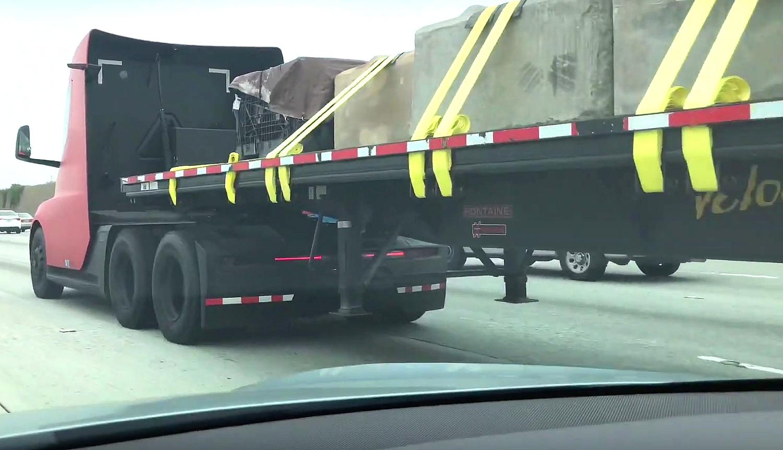 Tesla Semi spotted hauling trailer full of massive concrete blocks in Los Angeles