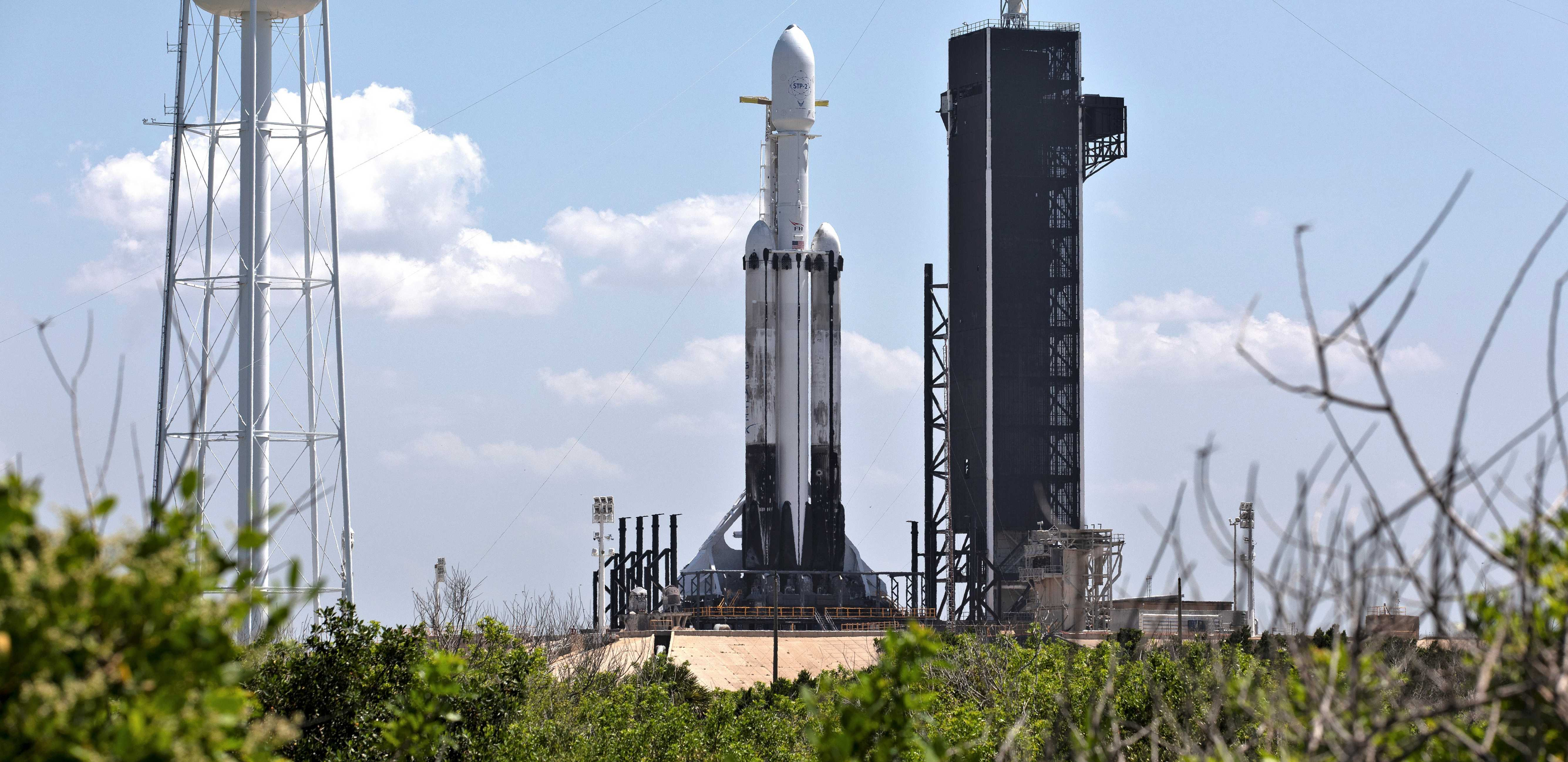 Falcon Heavy Flight 3 made use of both flight-proven side boosters and a new center core. Note the scorched landing legs and sooty exteriors. (SpaceX)