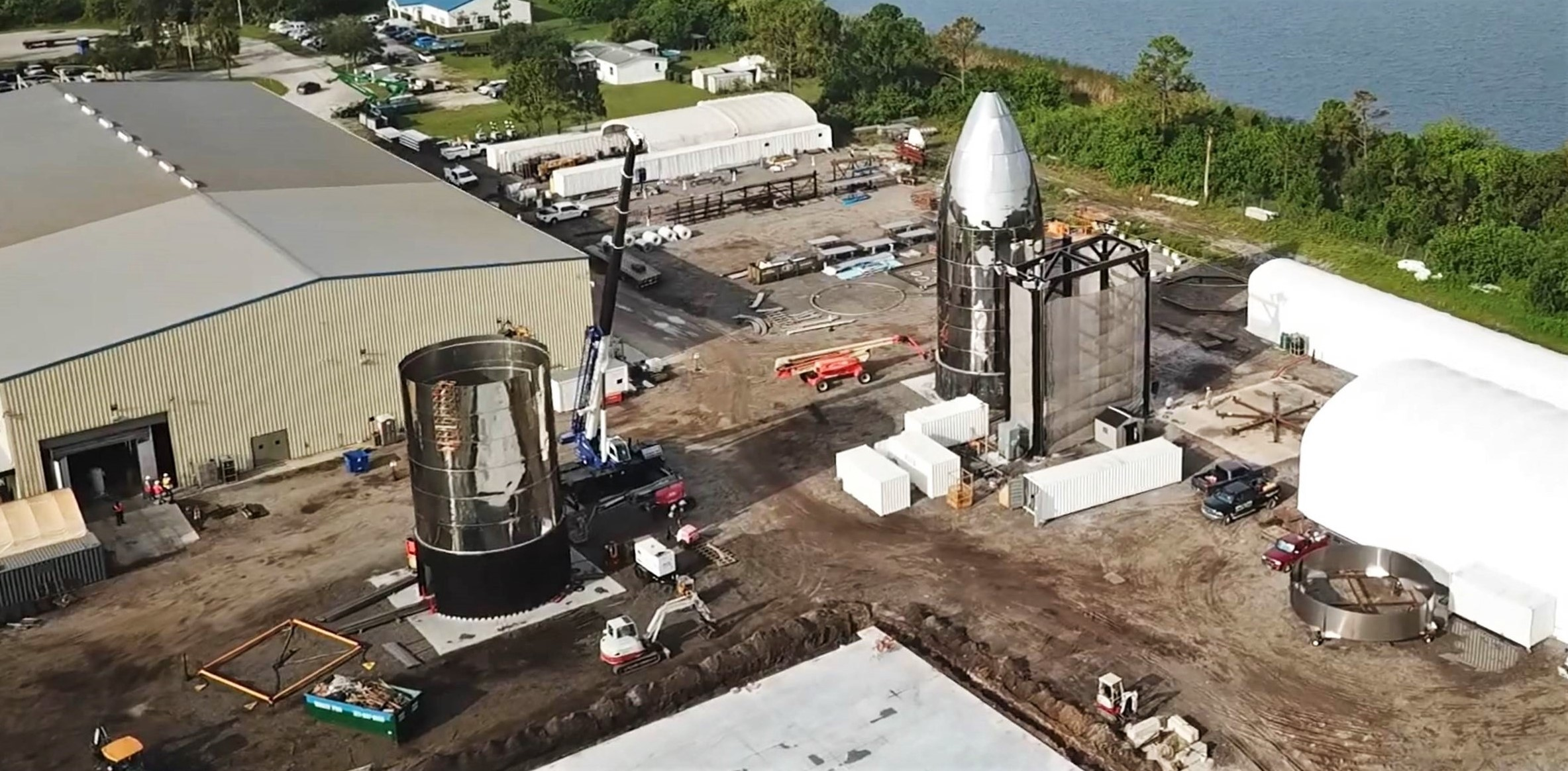 https://www.teslarati.com/wp-content/uploads/2019/07/SpaceX-Florida-Starship-facility-overview-070819-Michael-Tapes-9-crop.jpg