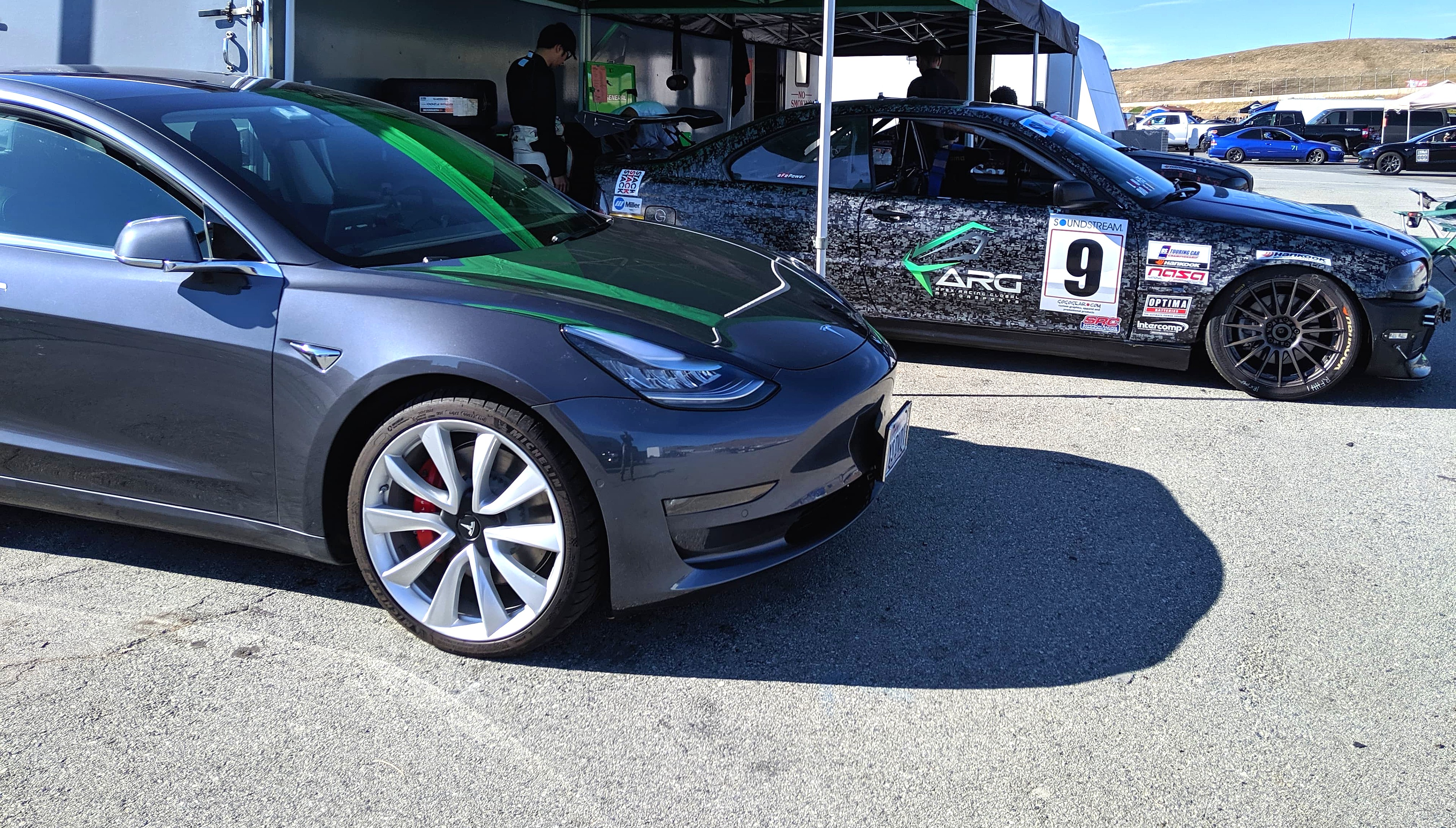 Tesla Model 3 makes BMW racer squeal in delight while riding