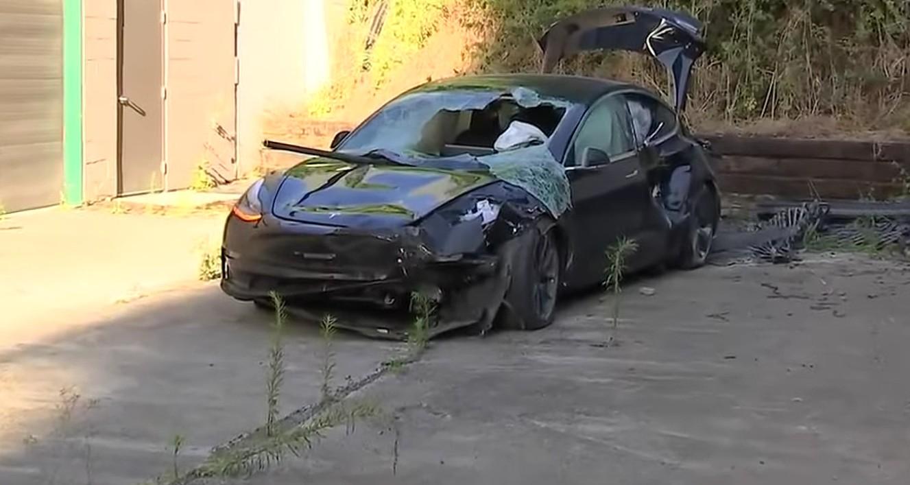 Tesla driver walks away unharmed after Model 3 falls 40 ft ...