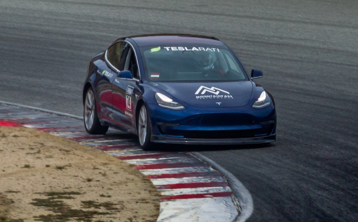 Tesla Model 3 with carbon fiber spoiler at Laguna Seca