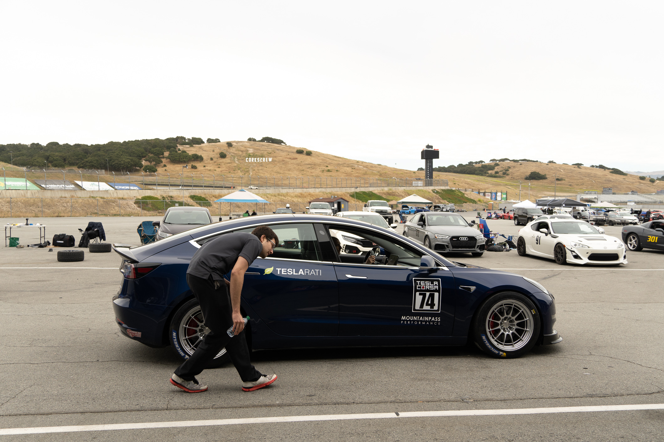 teslarati-mountain-pass-model-3-laguna-seca-paddock