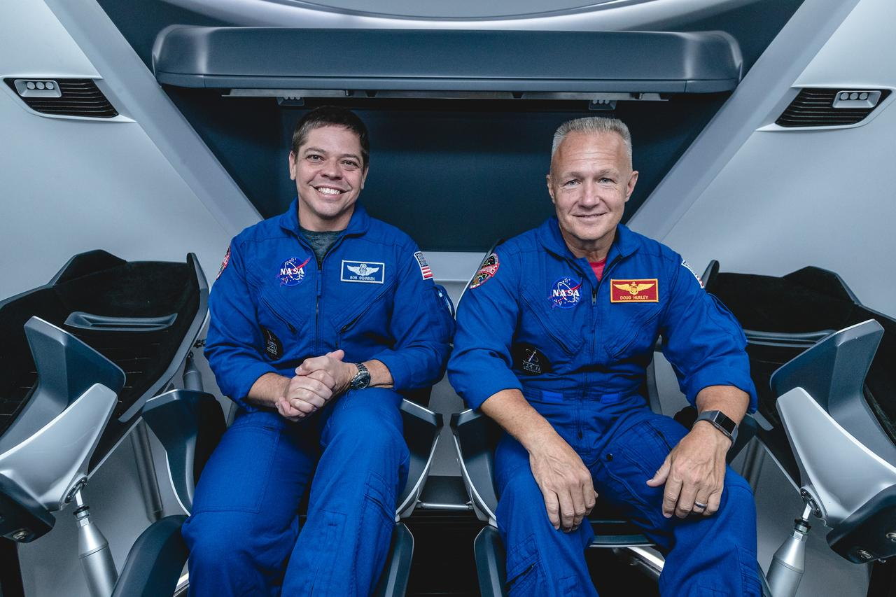 Astronauts Bob Behnken (Left) and Bob Hurley (Right) are pictured inside of a Crew Dragon mockup at Johnson Space Center. (NASA)