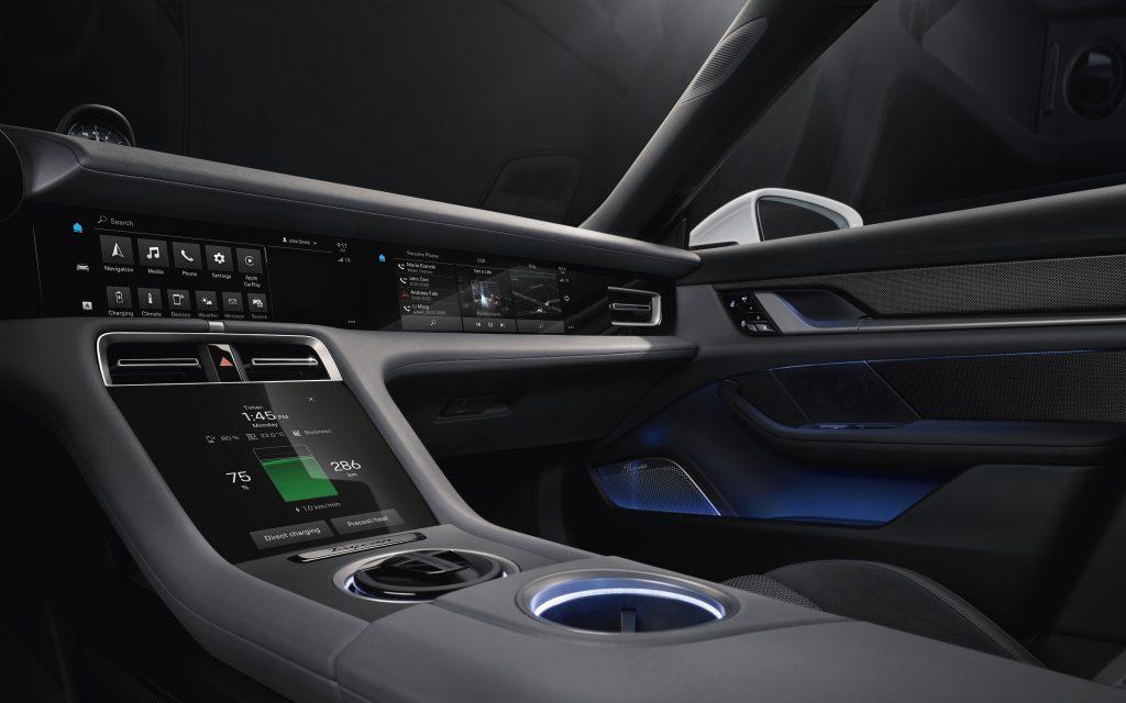 Porsche Taycan center touchscreens armrest cupholders