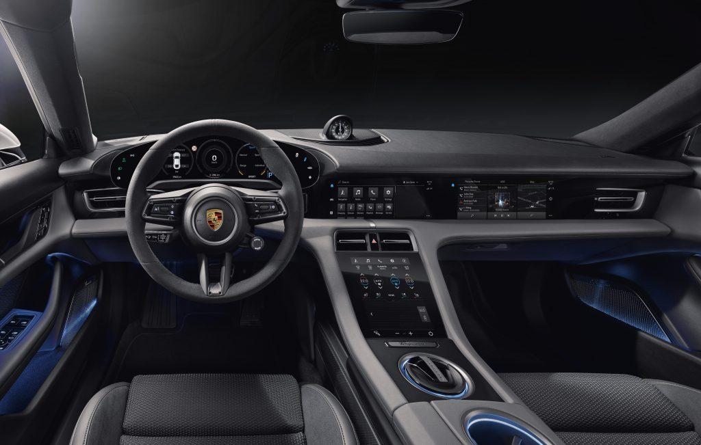 Porsche Taycan interior 5 touchscreens center armrest