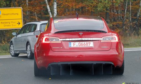 Red Tesla Model S P100D+ badge