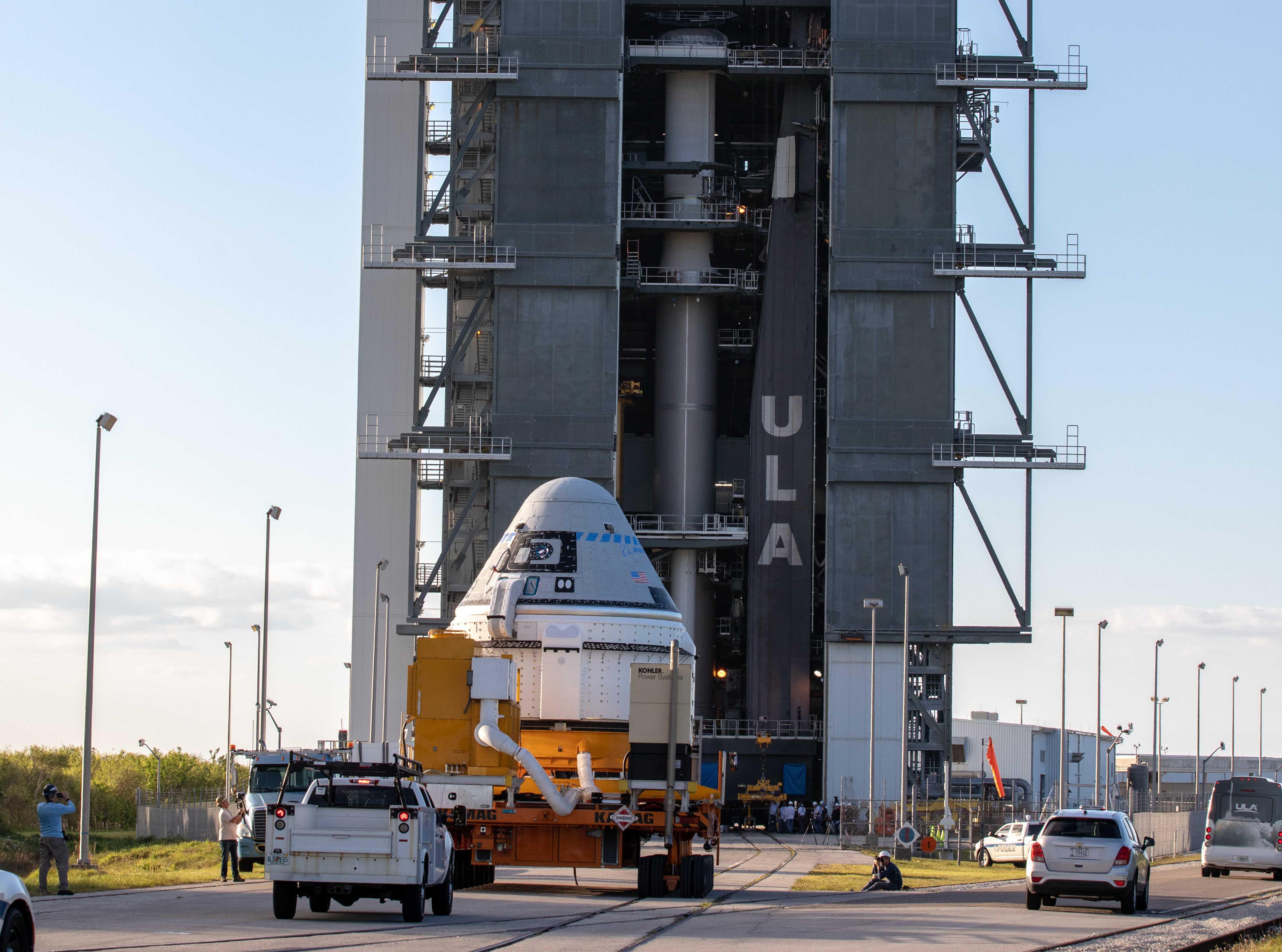 Starliner OFT rollout Atlas V 112119 (NASA – Cory Huston) 2 crop 1 (c)