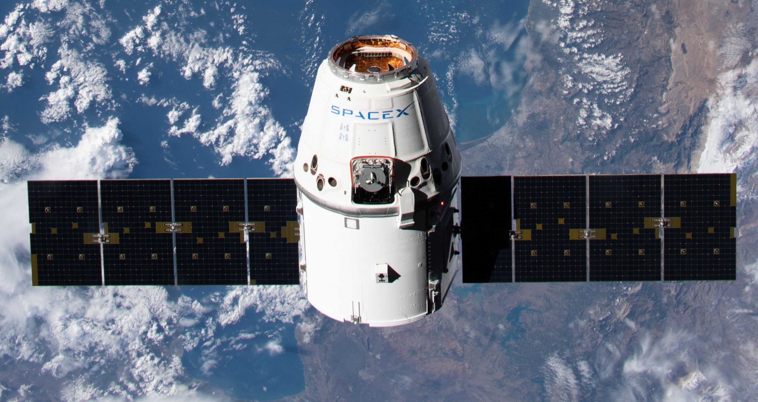 SpaceX Cargo Dragon spacecraft arrives at space station on