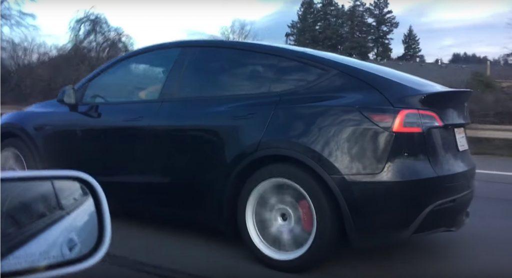 Black Tesla Model Y Performance With Red Brakes Looking