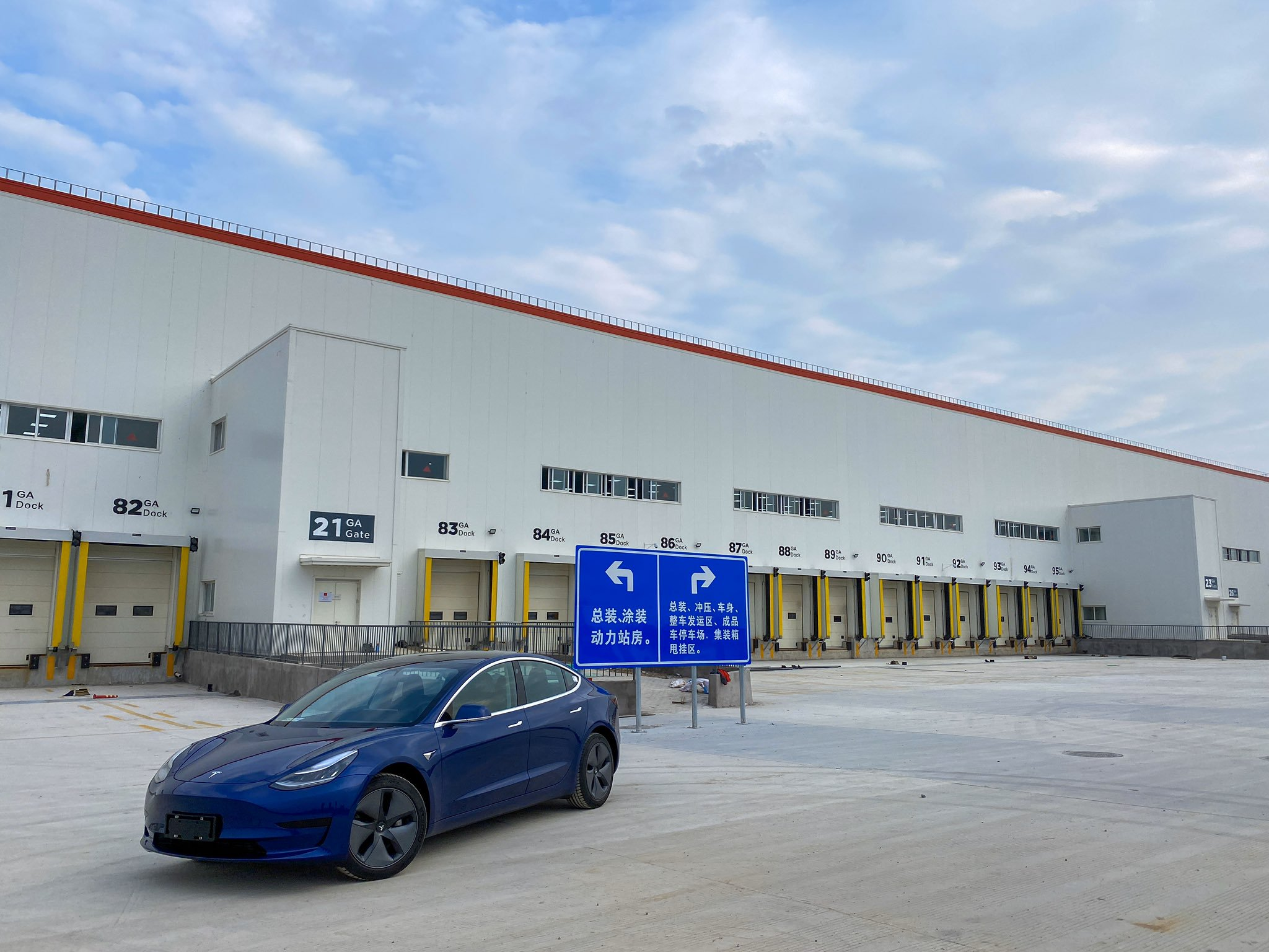 Made-in-China Tesla Model 3 in front of Shanghai Gigafactory