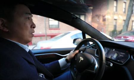 Andrew Yang behind the wheel of a Tesla Model X (Credit: Andrew Yang)