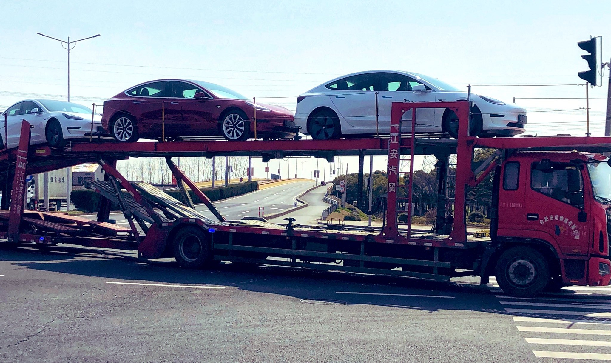 tesla-china-mic-model-3-delivery
