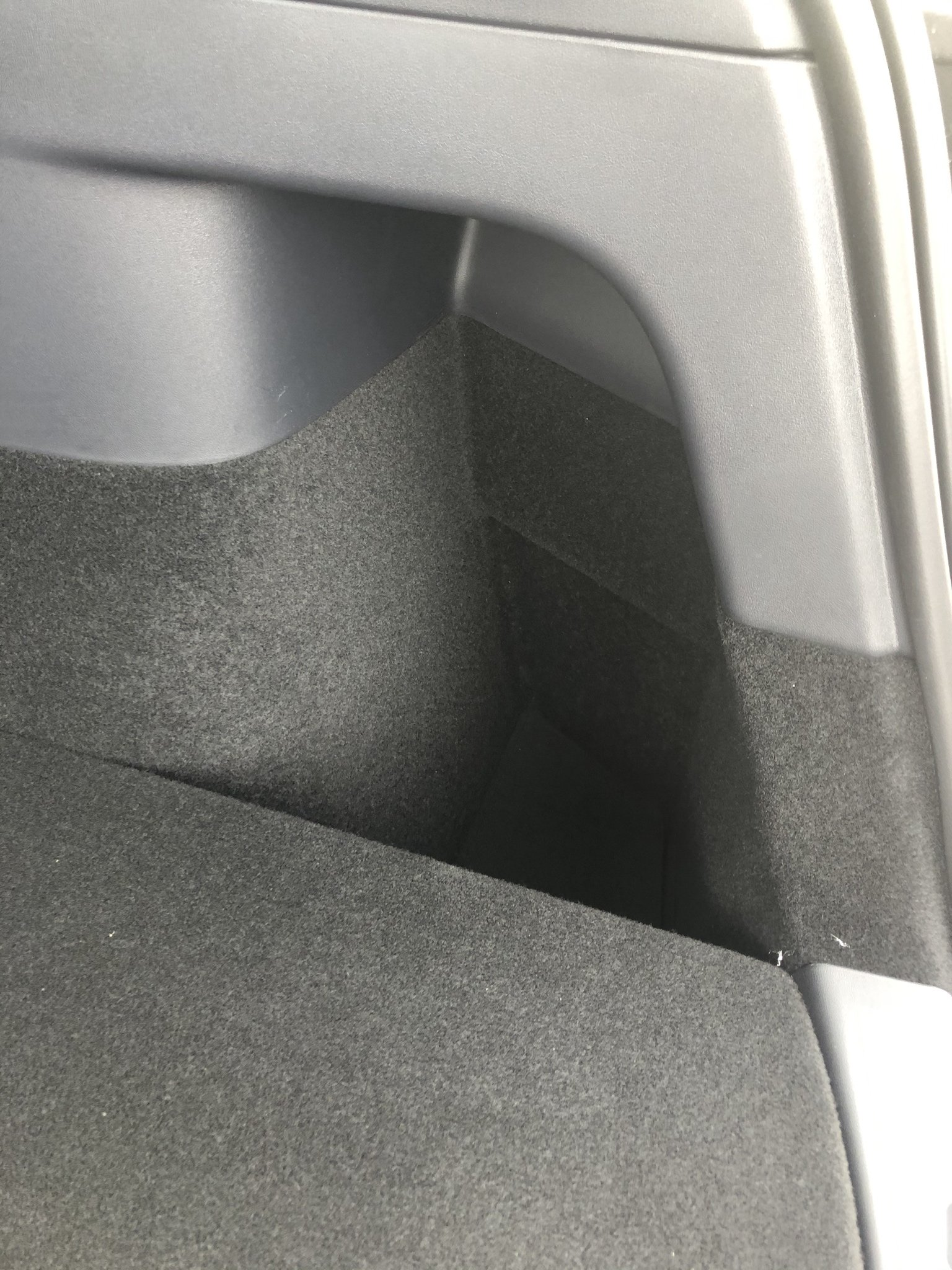 Tesla Model Y trunk side compartment