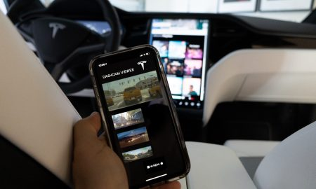 Concept image of a Tesla mobile app accessing Sentry Mode footage