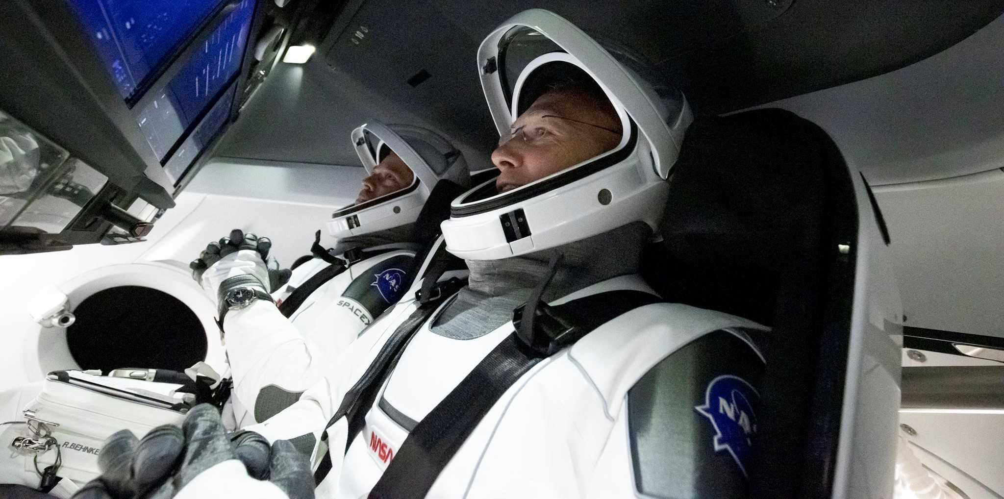 Crew Dragon Demo-2 Behnken Hurley 052720 (SpaceX) ingress 4 crop (c)
