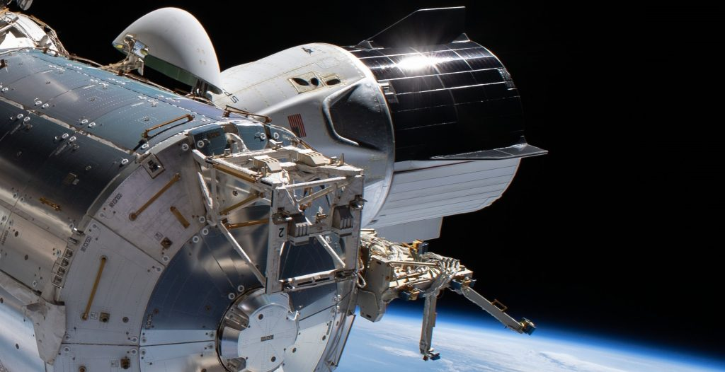 SpaceX Crew Dragon spacecraft caught on camera during NASA astronaut spacewalk - Teslarati
