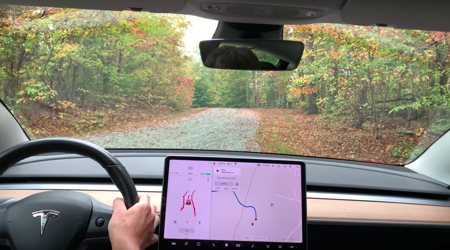tesla-fsd-unpaved-covered-road