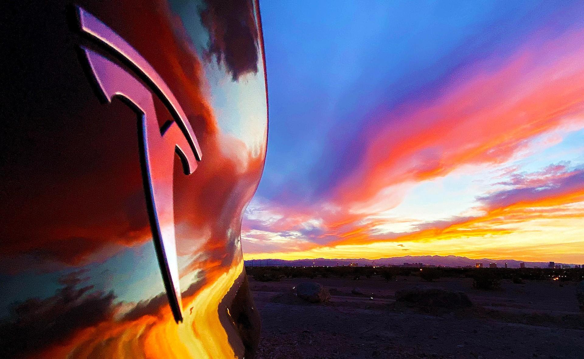 tesla-logo-sunset-red