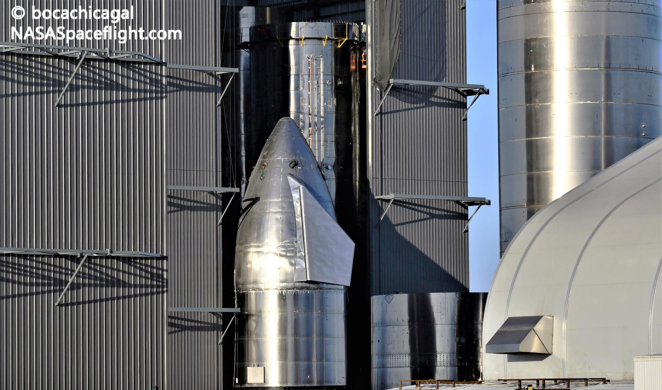 Starship Boca Chica 020721 (NASASpaceflight – bocachicagal) SN11 nose install + BN1 1 crop (c)