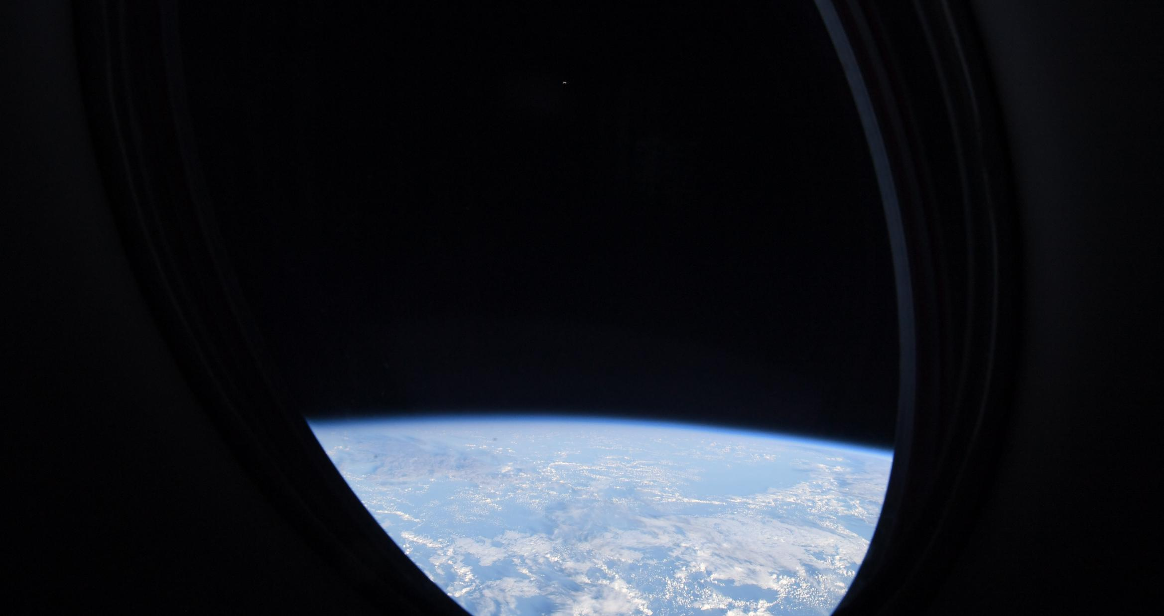 Crew-2 Crew Dragon C206 orbit ops 042421 (Thomas Pesquet – ESA) ISS window view 2 crop (c)
