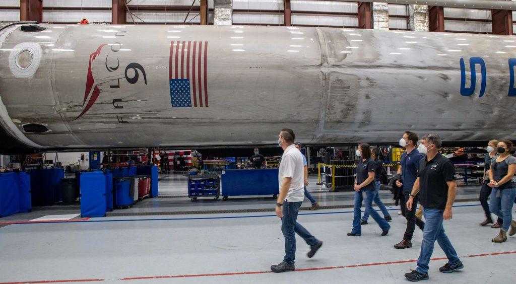 - Crew 2 Falcon 9 B1061 39A hangar tour Pesquet Kimbrough Hoshide McArthur 2021 SpaceX 1 c 1024x564 - SpaceX installs Dragon spaceship on the rocket that'll take it to space (again)